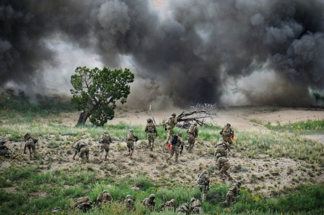 Soldiers assigned to 3rd Platoon, Bravo Company, 1st Battalion, 12th Infantry Regiment, 2nd Infantry Brigade Combat Team, 4th Infantry Division, conduct explosive breaching using bangalores alongside a team of engineers from Alpha Company, 52nd Brigade Engineer Battalion, 2IBCT, during the 1st Bn., 12th Inf. Reg. Platoon Live Fire Exercise, Aug. 14, 2019, on Fort Carson, Colo.