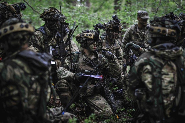 A U.S. Army Paratrooper assigned to the 173rd Airborne Brigade gives directions to his troops while participating in Exercise Immediate Response at Pocek Training Area, Slovenia, May 15, 2019. Exercise Immediate Response is a multinational exercise co-led by Croatian Armed Forces, Slovenian Armed Forces, and U.S. Army Europe. The logistics-focused exercise is designed to test and improve the ability to move forces and equipment rapidly from one location to another. The exercise will improve readiness and interoperability among participating allied and partner nations.