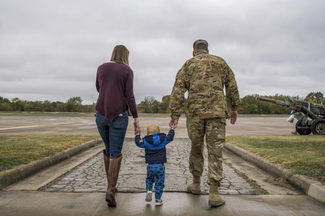 A Soldier assigned to the Oklahoma National Guard walks with loved ones at an Army aviation facility in Tulsa, Okla., Oct. 19, 2020, upon returning from a yearlong deployment to the U.S. Central Command area of operations.