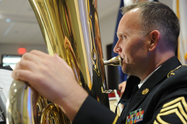 U.S. Army Reserve Sgt. 1st Class Jason Butler, a tuba player with the 380th Army Reserve Band, warms up by playing scales before the band's performance at the 64th annual Commonwealth's Veterans Day Ceremony at the Virginia War Memorial in Richmond, Va., Nov. 11, 2020. The band played patriotic music, including a service medley for the 250 guests in attendance and anyone watching the livestream online.