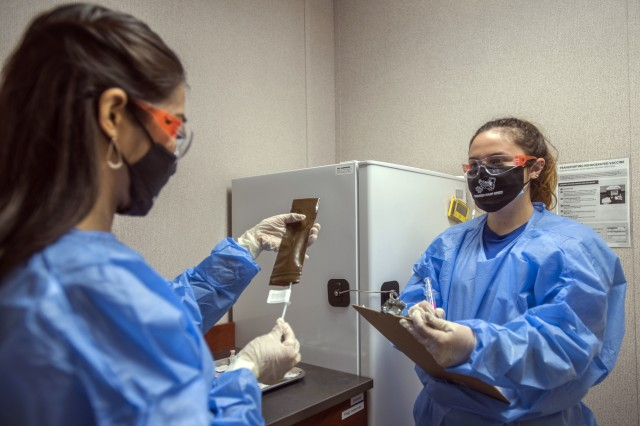 Alejandra Ornelas, Operation Warp Speed research pharmacy technician, documents and verifies whether a patient receives a vaccine or placebo, Oct. 28, 2020, at Joint Base San Antonio-Lackland, Texas. The U.S. Food and Drug Administration authorized the restart of AstraZeneca's Phase 3 clinical trial, Oct. 26, 2020.