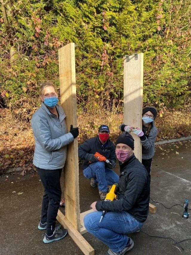 Volunteers craft wooden plant boxes