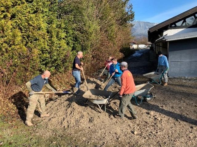 Volunteers shovel gravel