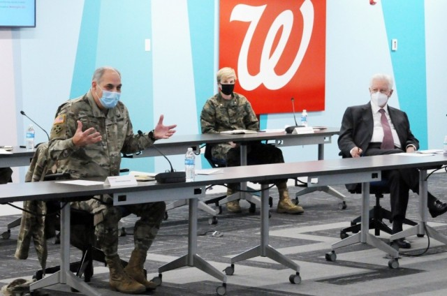Operation Warp Speed Chief Operating Officer Army Gen. Gus Perna, left, and Stefano Pessina, executive vice chairman and chief executive officer of Walgreens Boots Alliance, join other company leaders to discuss details of COVID-19 vaccine distribution and administration, Nov. 16, 2020. Walgreens and CVS pharmacies are integral to the vaccine distribution.