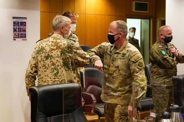 German Army Brig. Gen. Uwe Becker (left), Deputy Chief of Staff for Operations for Allied Land Command, and U.S. Army Lt. Gen. John Kolasheski, V Corps Commander, give the standard COVID-19 compliant greeting.  They were part of discussions on land domain collaboration held Thursday by U.S. Army land forces commanders for Europe and Africa and LANDCOM and select staff at LANDCOM headquarters in Izmir, Turkey.