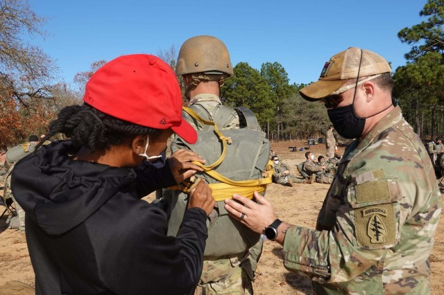 Jump Masters conduct their pre-checks on Soldiers before they participate in Operation Toy Drop hosted by the 95th Civil Affairs Brigade, Special Operations, Airborne, at Fort Bragg, N.C., December 4, 2020. Soldiers from the United States Army Special Operations Command community donated over 500 toys that were then given to Toys for Tots.