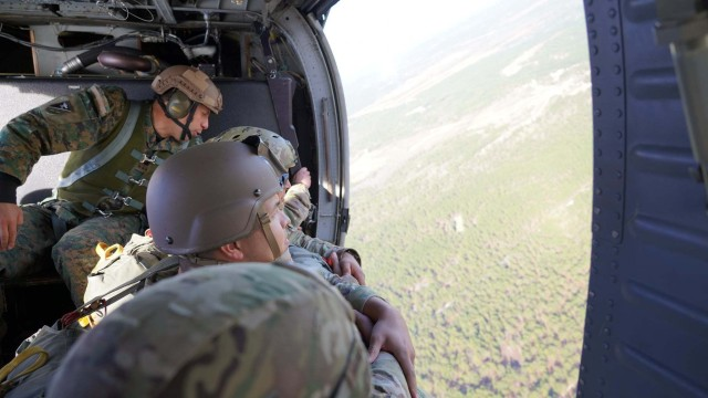 Soldiers from the United States Special Operations Command community take part in Airborne Operations, as part of Operation Toy Drop, hosted by the 95th Civil Affairs Brigade, Special Operations, Airborne, at Fort Bragg, N.C., December 4, 2020. For the past 20 years, USASOC has hosted Operation Toy Drop, which donates the toys collected and then gives them to Toys for Tots.