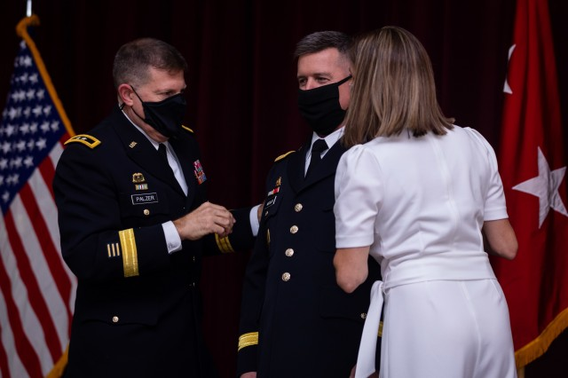 U.S. Army Reserve Maj. Gen. Mark W. Palzer, commanding general of the 99th Readiness Division, and Philomena Meisler pin on one-star epaulets onto Brig. Gen. Kevin Meisler's shoulders during his promotion ceremony held at Joint Base San Antonio-Fort Sam Houston Dec. 5, 2020. (U.S. Army photo by Capt. David Gasperson)