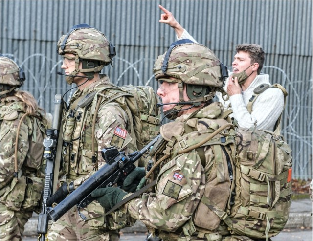 FORT BENNING, Ga. – U.S. Army 2nd Lt. Alexander Nappi (third from right), an Infantry officer, during training this year while attending Britain's Royal Military Academy Sandhurst. While in Officer Candidate School at Fort Benning in 2019, Nappi was elated when chosen to spend a year of rigorous training at Sandhurst. He started in January and finishes the year with the added distinction of having earned Sandhurst's International Award. It's given to the International Officer Cadet who achieves the best military, academic and practical scores in the class. Graduation is Dec. 11 with a ceremony known as the Sovereign's Parade. Nappi is slated to return to Fort Benning to attend the Infantry Basic Officer Leader Course (IBOLC).(Photo courtesy of British Army)