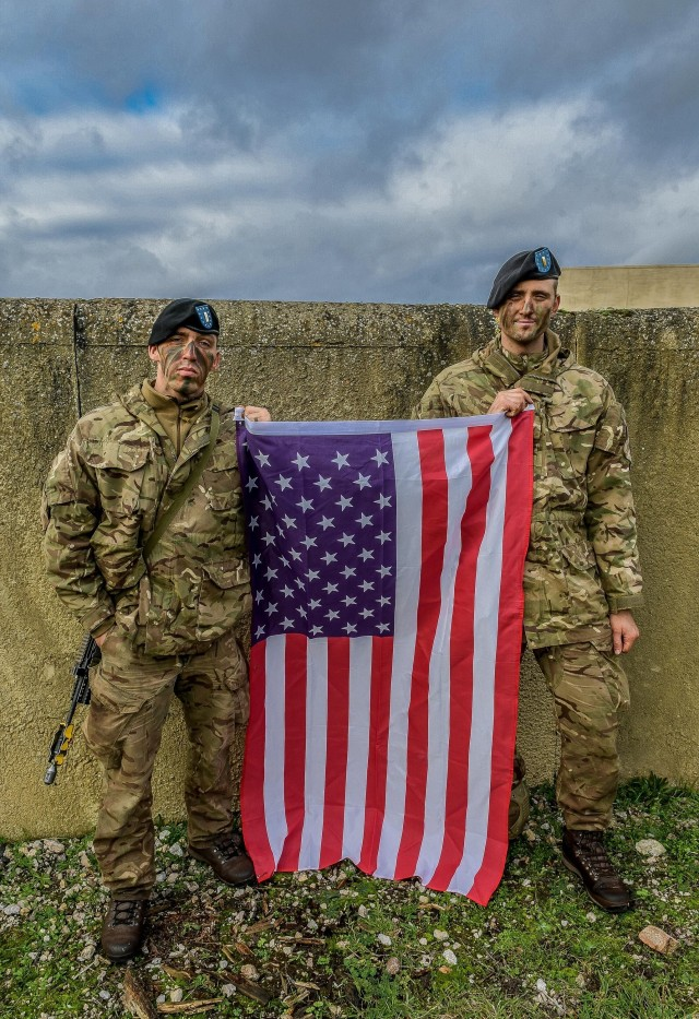 FORT BENNING, Ga. – Two U.S. Army officers attending Britain's Royal Military Academy Sandhurst this year, pose with the American flag. The officers, 2nd Lt. Elijah M. Villapiano (left), and 2nd Lt. Alexander Nappi, were selected for Sandhurst in 2019 while students at Officer Candidate School at Fort Benning. Being chosen for the course came after a rigorous selection process at OCS here. Both graduate from Sandhurst Dec. 11. Nappi ends the year as recipient of Sandhurst's International Award, given to the International Officer Cadet who achieves the best military, academic and practical scores in the class. Both return to Fort Benning for further training. Villapiano is slated to attend the Armor Basic Officer Leader Course (ABOLC), Nappi the Infantry Basic Officer Leader Course (IBOLC).  (Photo courtesy of British Army)
