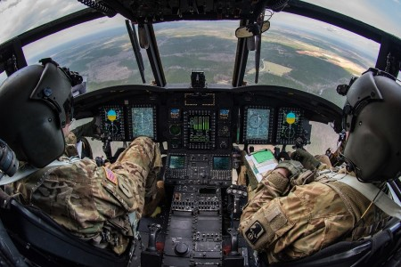 CH-47 Chinook helicopter pilots from the 159th General Support Aviation Battalion fly after taking off from Felker Army Airfield, Joint Base Langley-Eustis, Va., March 6, 2020.