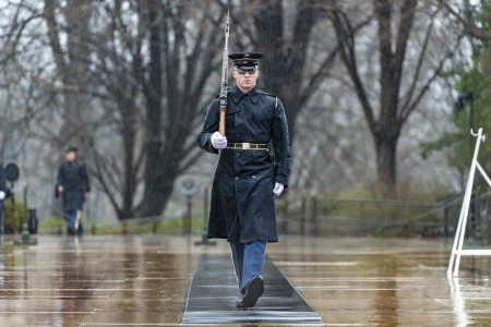 A sentinel walks the mat in front of the Tomb of the Unknown Soldier during a rainy day at Arlington National Cemetery, Arlington, Va., Feb. 25, 2020.