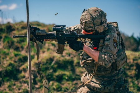 A U.S. Soldier fires an M4 carbine rifle during an advanced rifle marksmanship training event in support of NATO's enhanced Forward Presence Battle Group Poland in Bemowo Piskie, Poland, April 22, 2020.