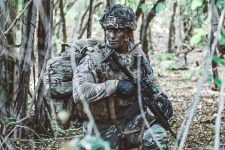 A Soldier conducts tactical movements after having air assaulted to an area near the objective, in Hawaii, Jan. 27, 2020.