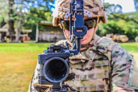 A U.S. Army Soldier checks an M-320 grenade launcher prior to qualifying at Schofield Barracks Hawaii, Aug. 6, 2020.