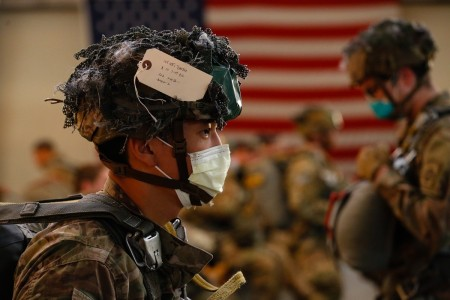 Sgt. Timothy Lee, a Paratrooper with the 1st Brigade Combat Team, 82nd Airborne Division, prepares for an Airborne Operation at Fort Bragg, N.C., on May 7, 2020.