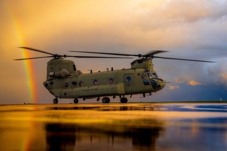 """A CH-47 Chinook from B Co """"Big Windy,"""" 1-214th General Support Aviation Battalion spins up for an evening training flight just after a storm clears, Oct. 6, 2020 at Katterbach Army Airfield, Katterbach, Germany"""
