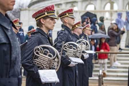 """Members of the U.S. Army Band, """"Pershing's Own"""" support an Army Full Honors Wreath-Laying Ceremony at the Tomb of the Unknown Soldier at Arlington National Cemetery, Arlington, Va., Feb. 25, 2020."""