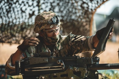 Sgt. Mark Lopez performs a functions check on a MK19 Grenade Machine Gun during Expert Soldier Badge (ESB) and Expert Infantry Badge (EIB) testing, Fort Hood, Texas, Aug. 24, 2020.