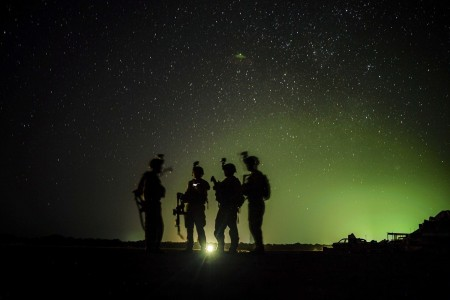 U.S. Army Soldiers standby for their night guard shift in Kenya, Jan. 20, 2020.