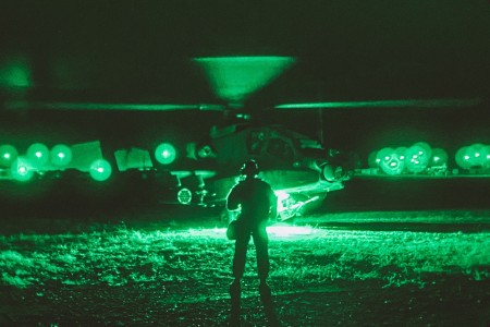 An AH-64 Apache pilot conducts pre-flight checks prior to lift off in support of an air assault exercise as part of force-on-force operations at the Joint Readiness Training Center at Fort Polk, La., Oct. 14, 2020.