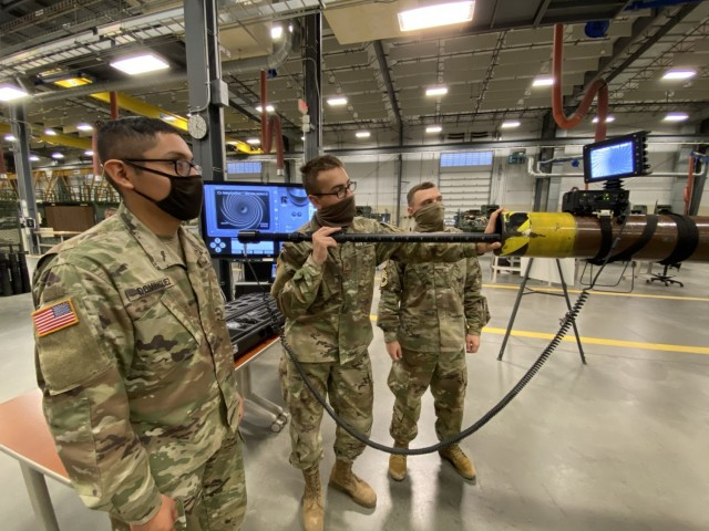 Ordnance students follow the process outlined in the IMI to internally inspect a gun tube using the video borescope with digital display.