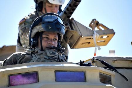 U.S. Army Sgt. Jasmine Jenkins communicates via radio during mounted machine gun range training at the 7th Army Training Command's Grafenwoehr Training Area, Germany, April 16, 2020.