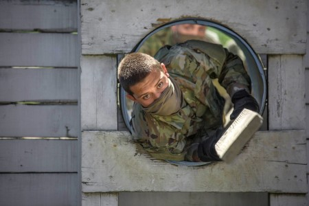 A trainee with 1st Battalion, 61st Infantry Regiment tackles the Teamwork Development Course during Basic Combat Training at Fort Jackson, S.C., April 27, 2020. The course toughens trainees mentally and physically as they transform from civilians to professionally trained Soldiers.