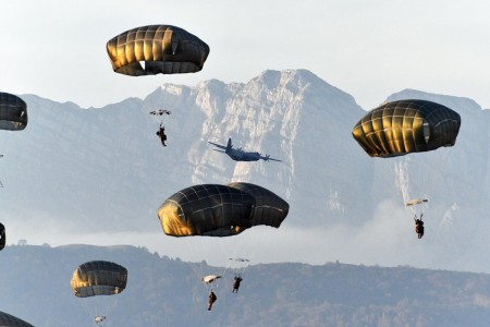U.S. Army paratroopers conduct airborne operation after exiting a C-130 Hercules aircraft at Juliet Drop Zone in Pordenone, Italy, Nov. 12, 2020.