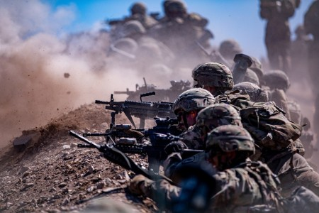 Paratroopers get up to the defensive position and unleash their weapon systems at targets downrange at a combined arms live fire lane in the Grafenwoehr Training Area, July 31, 2020.