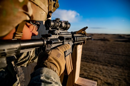 Staff Sgt. Joseph H. Miya aims down the sight of his M4 carbine while conducting the Army's new M16 and M4 carbine marksmanship qualification at Fort Sill, Okla., Jan. 23, 2020.