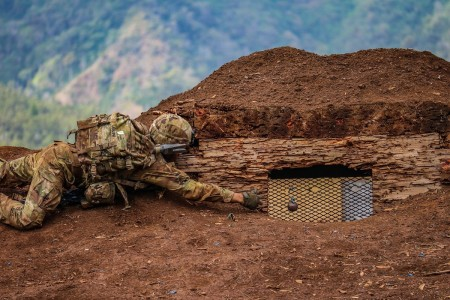 A Soldier tosses a grenade, simulating realistic conditions during platoon live fire training in Hawaii, Jan. 8, 2020.