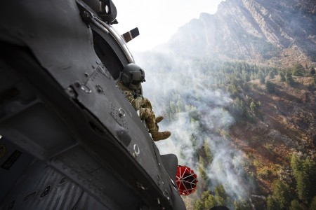 Crew members of the 211th Aviation Regiment conduct air support over the Neffs Canyon fire from a UH-60 Blackhawk helicopter in Salt Lake City, Utah, Sept. 20, 2020.