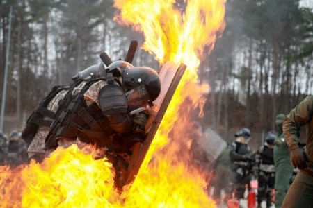 U.S. Soldiers defend against a thrown molotov cocktail while conducting fire phobia training, Feb. 24, 2020, in Hohenfels, Germany.