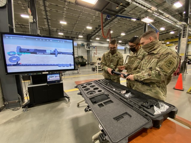 Students at the U.S. Army Ordnance School, Fort Lee, Virginia follow the steps provided by the video borescope interactive multimedia instruction (IMI) as they assemble the video borescope centering rings.