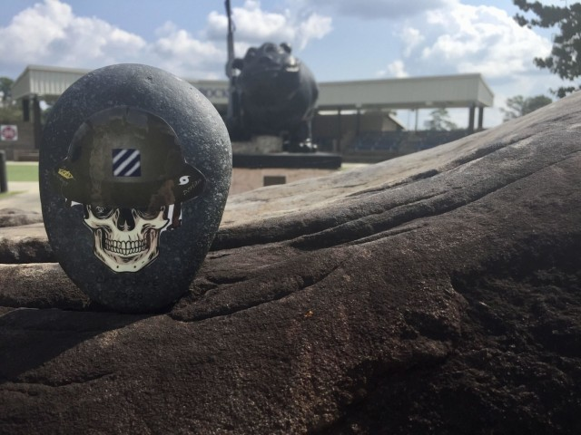"""Leadership can often be seen in the small things. The """"Rock of the DOC,"""" created by Maj. Steven Orbon, 3rd Infantry Division, is an award given for support beyond the call of duty to the division operations center. (U.S. Army photo by Staff Sgt. Dean Gannon)."""