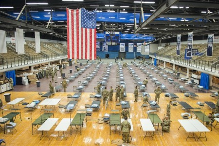 Soldiers from the Connecticut National Guard set up medical station equipment at Southern Connecticut State University in New Haven, Conn., April 1, 2020.