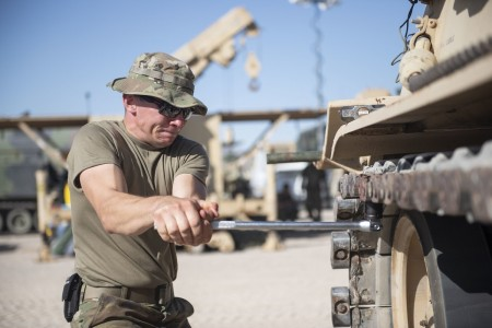 Spc. Adam Bartkowicz tightens the track of an M88 Recovery Vehicle, July 12, 2020, at Fort Irwin, Calif.