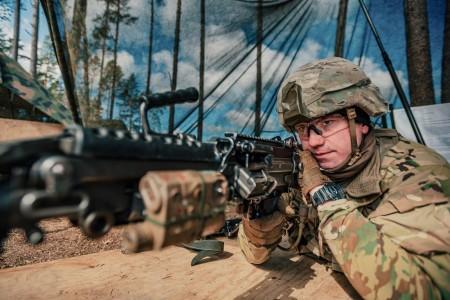 A U.S. Soldier, assigned to 3rd Squadron, 2d Cavalry Regiment, performs a functions check for a M249 Squad Automatic Weapon as part of the testing phase for the Expert Infantryman Badge and the Expert Soldier Badge in Bemowo Piskie, Poland, March 31, 2020.