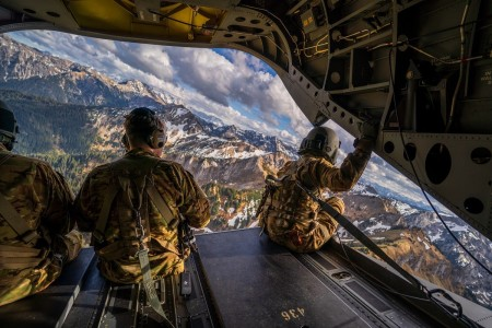 Soldiers enjoy the view from the ramp of a CH-47 Chinook during a high-altitude training flight in the Bavarian Alps, Germany, May 4, 2020.