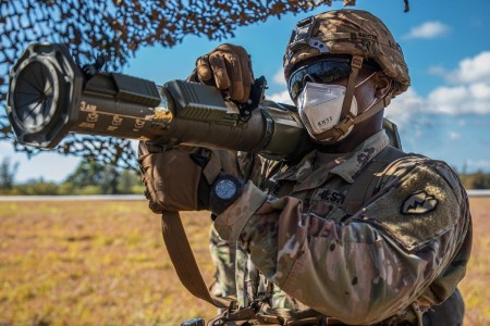 A Soldier checks the sight of a shoulder-fired rocket system during a test of his basic infantry and Soldier skills, Sept. 16, 2020 at Schofield Barracks, Hawaii.