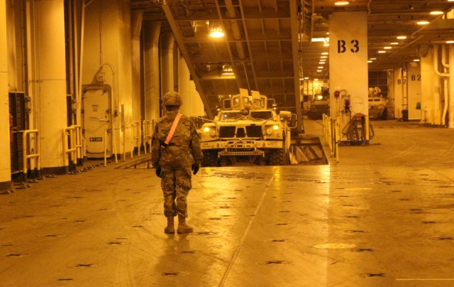 An MRAP drives out of the hold of the USNS Fisher during port operations at Pearl Harbor on Dec. 5.