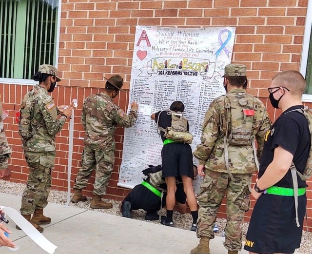 Bravo Company, 16th OD Battalion cadre and Soldiers sign the company Suicide Promissory Poster in support of the battalion's suicide awareness and prevention initiative.