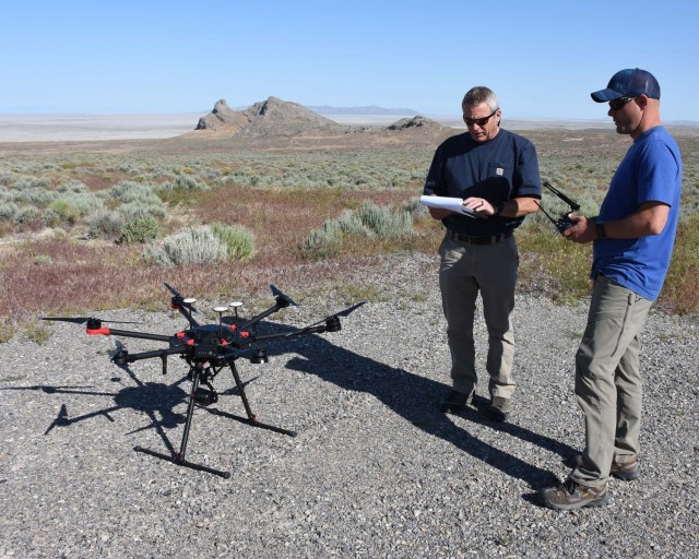 Project team members prepare to launch a small unmanned aircraft system (sUAS) to observe golden eagle nests on Dugway Proving Ground. The nests were observed for two years using three platforms to determine the strengths and weaknesses of each method. Dugway Proving Ground photo.