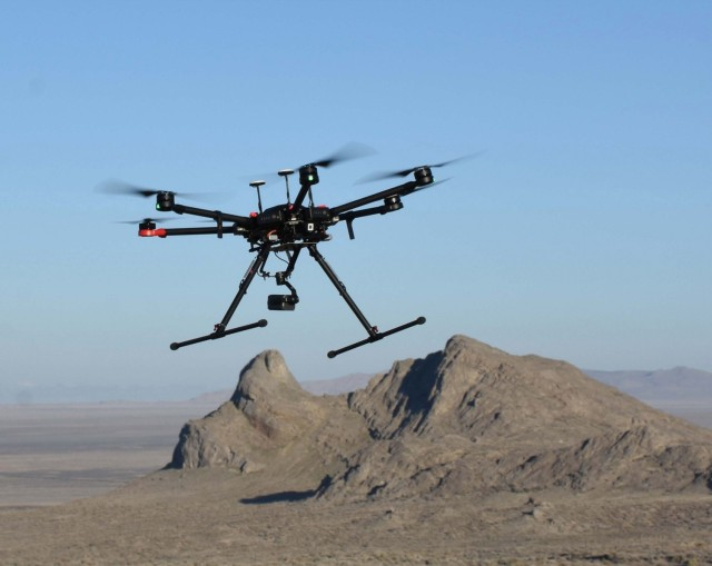 A small unmanned aircraft system (sUAS) is shown in flight at Dugway Proving Ground. The sUAS is one of three platforms utilized during a two-year study to locate golden eagle nests on the installation. The study was conducted to determine which platform worked best. Dugway Proving Ground photo.