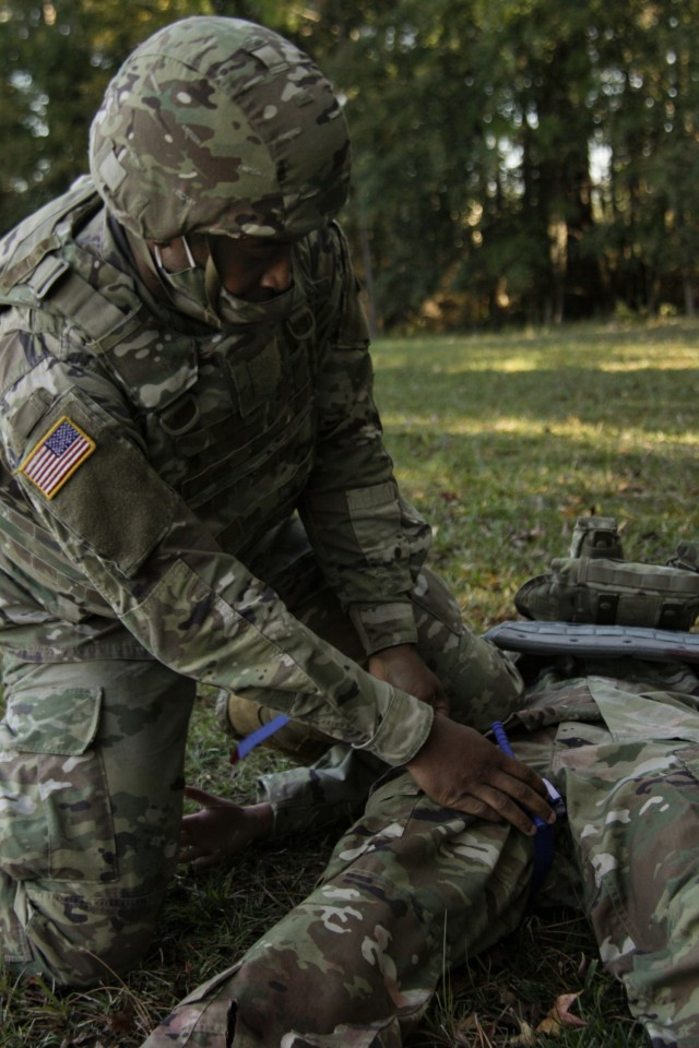 Sgt. Lawrence Lovejoy, a combat medic assigned to 3rd Squadron, 17th Cavalry Regiment, applies a tourniquet to a female mannequin during a training exercise at the Medical Simulation Training Center on Fort Stewart, Georgia, Dec. 2, 2020. The training focused on Soldiers applying tactical combat casualty care to a trial female mannequin. (U.S Army photo by Pfc. Aaliyah Craven)