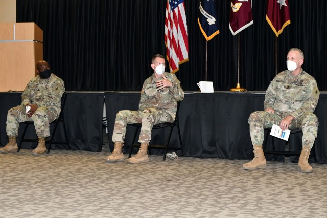 Cmd. Sgt. Maj. Clark Charpentier (center) answers a question on the Army Combat Fitness Test as Sgt. Maj. Larry White II and Maj. Gen. Dennis LeMaster look on.