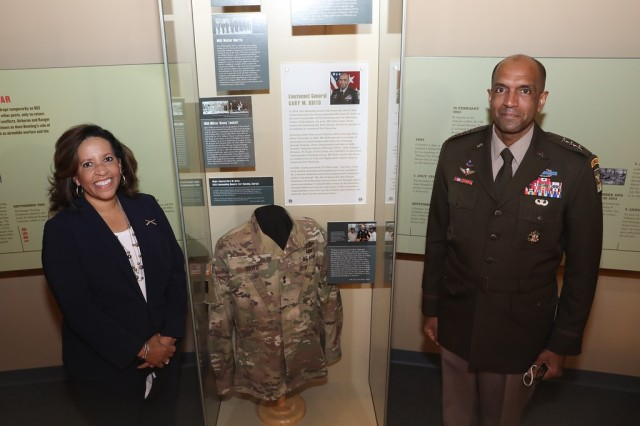 """FORT BENNING, Ga. – Lt. Gen. Gary M. Brito and his wife Michelle pose at a """"Diversity in Leadership"""" display moments after it was formally unveiled Dec. 11 at the National Infantry Museum, just outside Fort Benning in Columbus, Georgia. The display highlights three African American Soldiers whose service marked historic milestones in the Army's progress toward diversity. The three are: Brito, currently the Army's Deputy Chief of Staff G-1, but who in his previous assignment was the first African American commanding general of Fort Benning and its U.S. Army Maneuver Center of Excellence. Brito was the event's guest of honor and keynote speaker; Master Sgt. Walter Morris, who served during World War II as first sergeant with the Army's first All-African American Airborne unit, the 555th Parachute Infantry Company; and Master Sgt. Milton """"Davey"""" Lockett, the first African American in Army history to serve as an instructor at Fort Benning's elite U.S. Army Ranger School. Besides information panels and photographs, the display includes one of Brito's uniform jackets, bearing the two stars he wore as Fort Benning's commanding general.(U.S. Army photo by Markeith Horace, Maneuver Center of Excellence and Fort Benning Public Affairs)"""