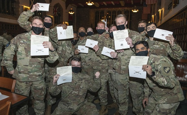 The cadets in the U.S. Military Academy's Class of 2021 burst into cheers and celebrate after they unsealed their envelopes during West Point's annual Branch Night Dec. 2 at Washington Hall. During the ceremony, 992 members of the class learned which of the 17 Army branches they were assigned. During Branch Night, 80% of the cadets received their top branch choice and 96% received one of their top three choices they worked hard for during their first three-and-a-half years at West Point. When meshing both the cadets and branches together, 96% of USMA cadets were Most Preferred or Preferred by the branch proponents.