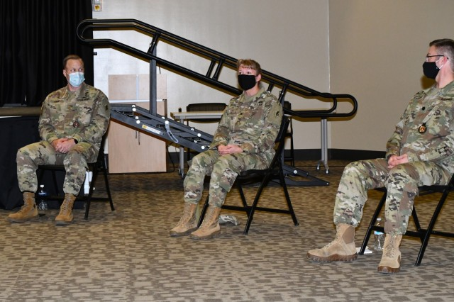 Col. Monica Douglas (center) shares her experiences with the Army Combat Fitness Test as Maj. Christopher Kahn and Lt. Col. Scott Scholfman look on.